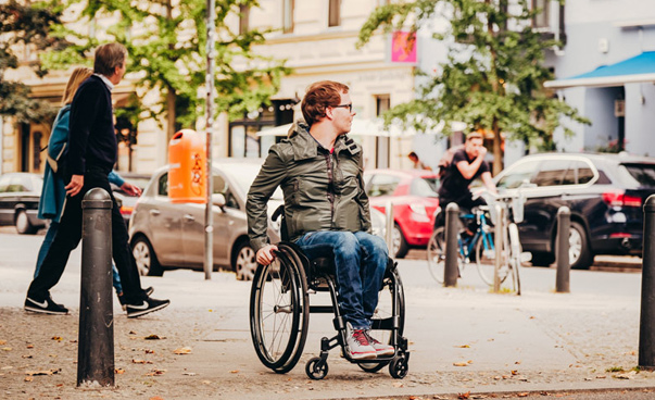 Man in a wheel chair. Photo: Andi Weiland visitBerlin