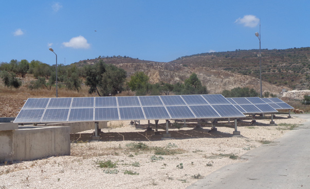 An arrangement of solar modules on a dry ground.